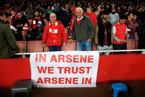 "Arsenal fans with a banner in support of manager Arsene Wenger in the stands during the Barclays Premier League match at the Emirates Stadium, London. PRESS ASSOCIATION Photo. Picture date: Thursday April 21, 2016. See PA story SOCCER Arsenal. Photo credit should read: Nick Potts/PA Wire. RESTRICTIONS: EDITORIAL USE ONLY. No use with unauthorised audio, video, data, fixture lists, club/league logos or ""live"" services. Online in-match use limited to 75 images, no video emulation. No use in betting, games or single club/league/player publications."