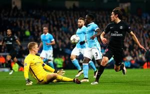 MANCHESTER, ENGLAND - APRIL 12:  Joe Hart of Manchester City makes a save from Edinson Cavani of Paris Saint-Germain during the UEFA Champions League quarter final second leg match between Manchester City FC and Paris Saint-Germain at the Etihad Stadium on April 12, 2016 in Manchester, United Kingdom.  (Photo by Clive Brunskill/Getty Images)