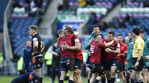 Munster's Keith Earls (number 11) and Arno Botha celebrate after the final whistle in Edinburgh (Ian Rutherford/PA)