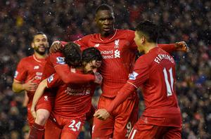 Liverpool's Welsh midfielder Joe Allen (2L) celebrates with teammates after scoring during the English Premier League football match between Liverpool and Arsenal at Anfield stadium in Liverpool, north-west England on January 13, 2016. AFP PHOTO / PAUL ELLIS RESTRICTED TO EDITORIAL USE. NO USE WITH UNAUTHORIZED AUDIO, VIDEO, DATA, FIXTURE LISTS, CLUB/LEAGUE LOGOS OR 'LIVE' SERVICES. ONLINE IN-MATCH USE LIMITED TO 75 IMAGES, NO VIDEO EMULATION. NO USE IN BETTING, GAMES OR SINGLE CLUB/LEAGUE/PLAYER PUBLICATIONS.PAUL ELLIS/AFP/Getty Images