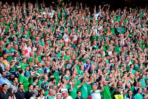 Northern Ireland fans in the stands pay tribute to the Robert Rainey who died during the Ukraine group game.