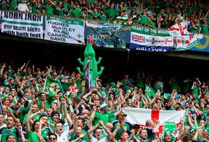 PARIS, FRANCE - JUNE 21:  Northern Ireland supporters cheer for their team after the UEFA EURO 2016 Group C match between Northern Ireland and Germany at Parc des Princes on June 21, 2016 in Paris, France.  (Photo by Clive Mason/Getty Images)