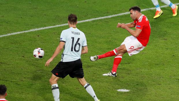Wales' Hal Robson Kanu, right, shoots to score next to Belgium's Thomas Meunier during the Euro 2016 quarterfinal soccer match between Wales and Belgium, at the Pierre Mauroy stadium in Villeneuve dAscq, near Lille, France, Friday, July 1, 2016. (AP Photo/Michael Sohn)