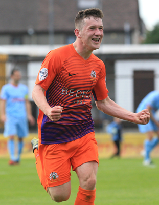 Strike: Bobby Burns enjoys the moment after his eyecatching goal