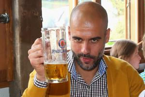 MUNICH, GERMANY - OCTOBER 05:  Josep Guardiola, head coach of Bayern Muenchen attend the Oktoberfest beer festival at Kaefer Wiesnschaenke tent at Theresienwiese on October 5, 2014 in Munich, Germany.  (Photo by Alexander Hassenstein/Bongarts/Getty Images)