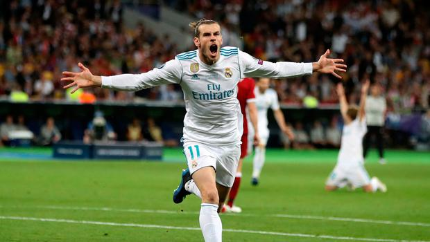 Real Madrid's Gareth Bale celebrates scoring his side's second goal of the game during the UEFA Champions League Final at the NSK Olimpiyskiy Stadium, Kiev. Nick Potts/PA Wire