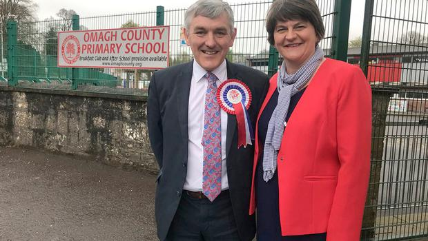 DUP handout photo of DUP leader Arlene Foster with Thomas Buchanan  outside Omagh County primary school during voting in the West Tyrone parliamentary by-election. PRESS ASSOCIATION Photo. Picture date: Thursday May 3, 2018. Voting is under way in the Westminster by-election triggered when the last MP quit amid claims he mocked victims of the Northern Ireland Troubles. See PA story POLITICS Election WestTyrone. Photo credit should read: DUP/PA Wire  NOTE TO EDITORS: This handout photo may only be used in for editorial reporting purposes for the contemporaneous illustration of events, things or the people in the image or facts mentioned in the caption. Reuse of the picture may require further permission from the copyright holder.