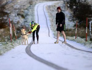 Runners as Snow Fall on the Divis Road on the Outskirts of Belfast , With Snow falling across parts of Northern Ireland  Pic Colm Lenaghan/Pacemaker 8/12/2014