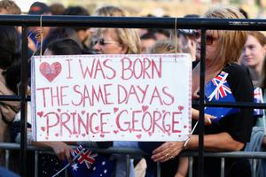 Royal supporters wait for the arrival of the Duke and Duchess of Cambridge at the Sydney Opera House on April 16, 2014 in Sydney, Australia. The Duke and Duchess of Cambridge are on a three-week tour of Australia and New Zealand, the first official trip overseas with their son, Prince George of Cambridge.  (Photo by Cameron Spencer/Getty Images)