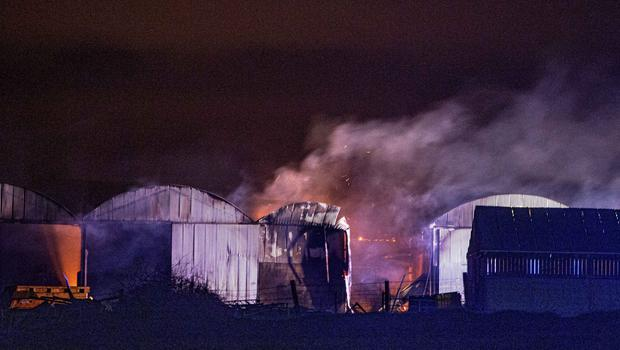 Over 50 firefighters tackled a large blaze on a farm on Ballyclough Road, Bushmills. A number of sheds and machinery were destroyed. Pic Steven McAuley/McAuley Multimedia