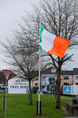 A flag flies at half mast in the bogside area of Londonderry after the death of Northern Ireland's former deputy first minister and ex-IRA commander Martin McGuinness aged 66. Niall Carson/PA Wire