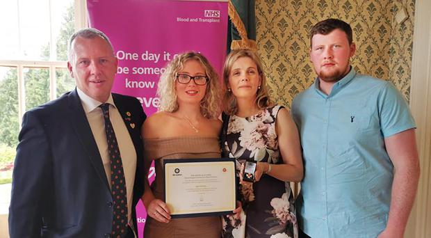 Kyra's parents Raymond and Valerie and siblings Alex and Glenn receiving the Order of St John Award for Organ Donation at a ceremony at Belfast Castle this week