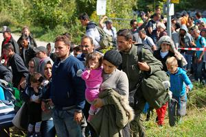 FREILASSING, GERMANY - SEPTEMBER 16:  Several hundred migrants who had arrived on foot from the Salzburg train station in Austria cross the border to Germany on September 16, 2015 at Freilassing, Germany. Hundreds of migrants who had been stuck in Salzburg and unable to find available seats on trains going to Germany broke off in groups to reach the nearby border to Germany on foot. German authorities have temporarily reinstated border controls along Germany's border to Austria and are conducting spot checks on arriving traffic. Germany is still accepting up to thousands of new migrants daily but has imposed border controls in order to crack down on smugglers and to better regulate the flow of arriving migrants, tens of thousands of whom arrived in Germany over the last few weeks. Meanwhile Hungary has sealed it new fence along its border to Serbia and migrants are now heading to Croatia in an effort to reach western Europe..  (Photo by Sean Gallup/Getty Images)