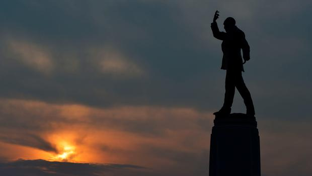BELFAST, NORTHERN IRELAND - SEPTEMBER 10:  Sir Edward Carson's statue can be seen as the sun sets at Stormont on September 10, 2015 in Belfast, Northern Ireland. A political crisis has erupted in the province following the murder of former IRA member Kevin McGuigan Sr last month. The Police Service of Northern Ireland stated that they believed there was IRA involvement in the killing of one of it's former members. The Democratic Unionist Party has said that if the Northern Ireland Executive goverment is not adjourned or suspended until a thorough investigation into any IRA involvement has been concluded that their ministers will stand down within 24 hours. Sinn Fein has denied IRA involvement in the the murder and refuted that the IRA still exists.  (Photo by Charles McQuillan/Getty Images)