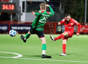 Big guns: Larne winger Marty Donnelly gets his shot past Glentoran's Rhys Marshall during their Premiership match at Inver Park last month