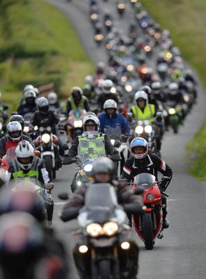 Pacemaker Press 7/7/2015 Motorcyclists pay tribute to the late road racing doctor John Hinds on Tuesday by riding with his cortege during a lap of the Tandragee 100 course, Which was his favourite  road racing circuit  . The well-known ?flying doctor? died on Saturday following a crash during a practice session at the Skerries 100 in the Republic of Ireland.  Dr Hinds was a intensive care consultant and anaesthetist at Craigavon Hospital in Co Armagh but frequently attended road races to provide medical cover. Pic Colm Lenaghan/Pacemaker