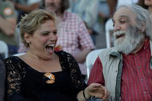 "Supporters of the No vote react after the referendum's exit polls at Klafthmonos square in Athens, Sunday, July 5, 2015. Greece faced an uncharted future as officials counted the results of a referendum Sunday on whether to accept creditors' demands for more austerity in exchange for rescue loans, with three opinion polls showing a tight race with a narrow victory likely for the ""no"" side. (AP Photo/Petr David Josek)"