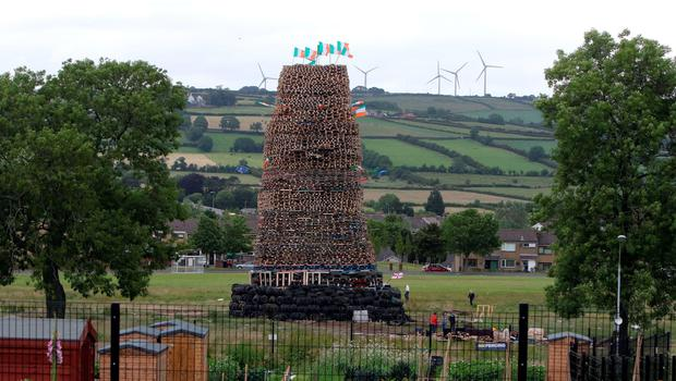 The New Mossley bonfire, one of the largest in the province is seen on the outskirts of Belfast. AFP PHOTO / PAUL FAITHPAUL FAITH/AFP/Getty Images.