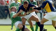 Double team: Gary Longwell and Anthony Foley tackle a Romanian while on duty for Ireland
