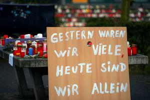 "A poster reading ""Yesterday we were many, today we are alone"" can be seen in front of a memorial of flowers and candles near the Joseph-Koenig-Gymnasium secondary school in Haltern am See, western Germany on March 25, 2015, from where some of the Germanwings plane crash victims came. AFP PHOTO / SASCHA SCHUERMANNSASCHA SCHUERMANN/AFP/Getty Images"