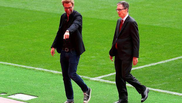 "Liverpool manager Jurgen Klopp with owner John Henry ahead of the opening of the Anfield Main Stand, Liverpool. PRESS ASSOCIATION Photo. Picture date: Friday September 9, 2016. Photo credit should read: Peter Byrne/PA Wire. RESTRICTIONS: EDITORIAL USE ONLY No use with unauthorised audio, video, data, fixture lists, club/league logos or ""live"" services. Online in-match use limited to 75 images, no video emulation. No use in betting, games or single club/league/player publications."