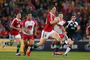 BRISBANE, AUSTRALIA - JUNE 08:  George North of the Lions charges upfield during the match between the Queensland Reds and the British & Irish Lions at Suncorp Stadium on June 8, 2013 in Brisbane, Australia.  (Photo by David Rogers/Getty Images)