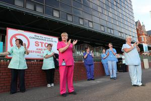 Nurses at the Mater Hospital in Belfast taking part in the last night of the Clap for Carers tribute. Picture by Stephen Davison/Pacemaker