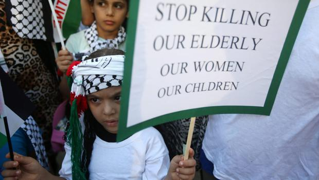 A Palestinian girl holds placard as she attends a protest against the war in Gaza, in Beirut, Lebanon, Monday July 21, 2014. (AP Photo/Hussein Malla)