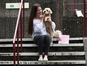 Pacemaker Press 24/8/2017  Top achiever Sarah Hand with mum Maria and Dog Kenny  who got 10 A* grades as Pupils at Victoria College in Belfast receive their GCSE results on Thursday. Around 30,000 pupils received their grades , as  Northern Ireland students  make steady improvements in GCSEs, with small rises across the grades in examinations in 2017. One in ten entries were awarded the top A* grade, with almost 80 percent achieving A* - C grades.