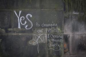 EDINBURGH, SCOTLAND - SEPTEMBER 18:  Political graffiti is seen close to Lothian Chambers polling station in central Edinburgh on September 18, 2014 in Edinburgh, Scotland. After many months of campaigning the people of Scotland today head to the polls to decide the fate of their country. The referendum is too close to call but a Yes vote would see the break-up of the United Kingdom and Scotland would stand as an independent country for the first time since the formation of the Union.  (Photo by Matt Cardy/Getty Images)