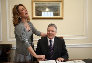 Northern Ireland's new First Minister Peter Robinson celebrates with his wife Iris at his desk at Parliament Buildings, Stormont, Northern Ireland, Thursday, June 5, 2008. The Northern Ireland Assembly has elected Protestant politician Peter Robinson to be the new leader of a power-sharing government alongside Catholics. (AP Photo/Peter Morrison)