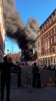 Screen grab taken with permission from a video posted by @MikeHolt12 on Twitter of a fire on Great Portland Street, London. Mike Holt/PA Wire