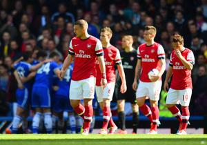 LONDON, ENGLAND - MARCH 22:  A dejected Lukas Podolski of Arsenal looks on during the Barclays Premier League match between Chelsea and Arsenal at Stamford Bridge on March 22, 2014 in London, England.  (Photo by Shaun Botterill/Getty Images)