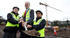 Education Minister Peter Weir with pupils Eimear Brown-McParland and Dominic Aby. Credit: Press Eye