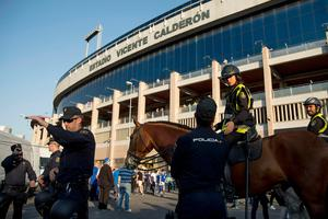 Police patrol outside the stadium before the UEFA Champions League quarter final first leg football match Club Atletico de Madrid vs Leicester City at the Vicente Calderon stadium in Madrid on April 12, 2017. / AFP PHOTO / CURTO DE LA TORRECURTO DE LA TORRE/AFP/Getty Images