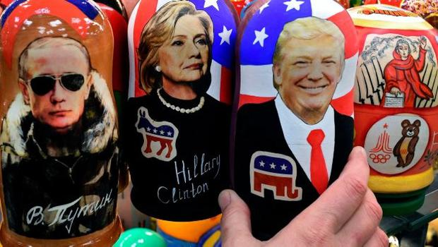 Traditional Russian wooden nesting dolls, Matryoshka dolls, depicting Russia's President Vladimir Putin, US Democratic presidential nominee Hillary Clinton and US Republican presidential nominee Donald Trump are seen on sale at a gift shop in central Moscow on November 8, 2016. A nervous world turned its gaze to America's 200 million-strong electorate November 8, 2016 as it chooses whether to send the first female president or a populist property tycoon to the White House. / AFP PHOTO / Kirill KUDRYAVTSEVKIRILL KUDRYAVTSEV/AFP/Getty Images