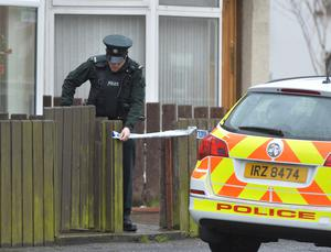 Police raid a home in Sunnyside Street in connection with Walmer Street murder. Pic Colm Lenaghan/Pacemaker