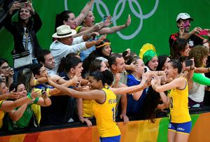 Brazilian players cheer their supporters during the women's qualifying volleyball match between Brazil and Argentina at the Maracanazinho stadium in Rio de Janeiro on August 8, 2016, during the 2016 Rio Olympics. / AFP PHOTO / Johannes EISELEJOHANNES EISELE/AFP/Getty Images