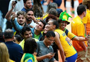 Brazil's Gabriela Braga Guimaraes poses for a picture with supporters after winning the women's qualifying volleyball match between Brazil and Argentina at the Maracanazinho stadium in Rio de Janeiro on August 8, 2016, during the 2016 Rio Olympics. / AFP PHOTO / Johannes EISELEJOHANNES EISELE/AFP/Getty Images