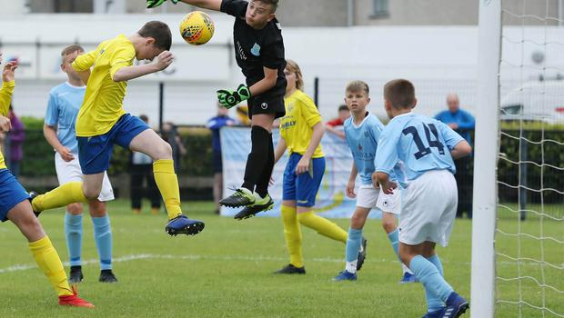 PressEye-Northern Ireland- 1st August 2019-Picture by Brian Little/PressEye Dungannon United Youth Ryan Donnelly header against  Ballymena United  in  STATSports SuperCupNI  Semi Final , at Anderson Park, Coleraine . Picture by Brian Little/PressEye