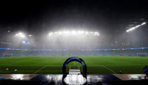 Heavy rain before the Champions League match between Manchester City and Borussia Monchengladbach at the Etihad Stadium, Manchester. PA