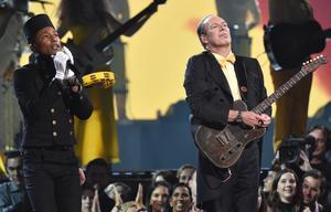 Pharrell Williams, left, and Hans Zimmer perform at the 57th annual Grammy Awards on Sunday, Feb. 8, 2015, in Los Angeles. (Photo by John Shearer/Invision/AP)