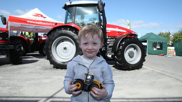 PressEye-Northern Ireland- 16th May 2018-Picture by Brian Little/ PressEye  Max Jess aged 3 from Kilkeel looking at the tractors  during the First day of the 2018 Balmoral Show, in partnership with Ulster Bank, at Balmoral Park  Picture by Brian Little/PressEye