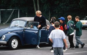 Jurgen Klinsmann arrives for training at Tottenham in his VW Beetle.