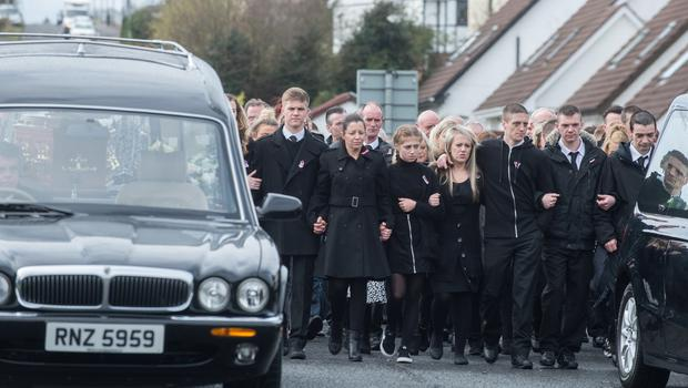 The funerals of Sean McGrotty, 46,  his two young sons Mark 12,  and Evan, 8,  Ruth Daniels, 57, the mother of Mr McGrottys partner Louise, who was in England at the time and Ms Daniels teenage daughter Jodie-Lee,15, who died when their car slipped into the water from a slipway in Buncrana at the weekend. Picture Martin McKeown. Inpresspics.com. 24.03.17