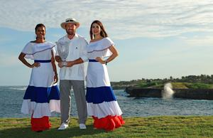 All smiles: Graeme McDowell shows off his trophy in the Dominican Republic