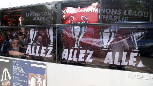 Liverpool FC fans on a shuttle bus taking them to the stadium (Steve Parsons/PA)