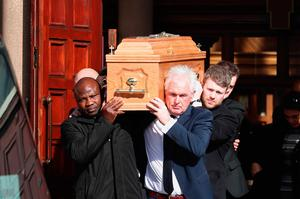 The coffin is carried from St Colmcille's Church, Holywood, Co Down at the funeral of boxing promoter and bookmaker Barney Eastwood.