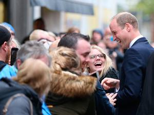 The Duke of Cambridge talks to wellwishers after his during a visit  to Inspire, a charity and social enterprise which focuses on promoting wellbeing for all across the island of Ireland, as part of his tour of Belfast. PRESS ASSOCIATION Photo. Picture date: Wednesday October 4, 2017.Niall Carson/PA Wire
