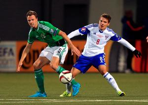 Northern Ireland's Jonny Evans (left) and Faroe Islands' Brandur Henriksen battle for the ball during the UEFA European Championship Qualifying match at the Torsvollur, Torshavn. Picture date: Friday September 4, 2015. See PA story SOCCER Faroe Islands. Photo credit should read: John Walton/PA Wire.